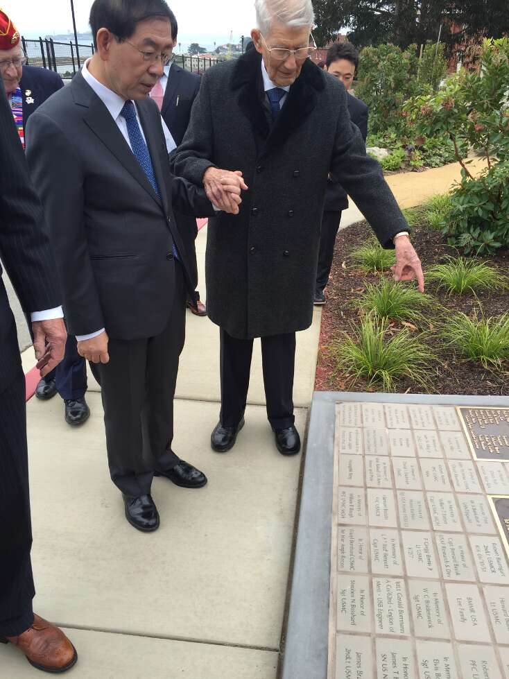 photo of Mayor Park and John Stevens reading tiles and plaques