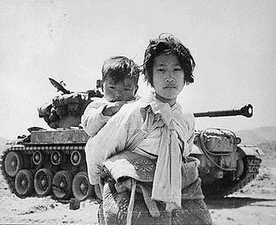 Young refugee with baby brother, Haeng-ju, June 9, 1951