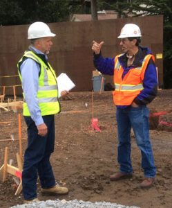 Lamb and Shoemaker having a discussion at the construction site.