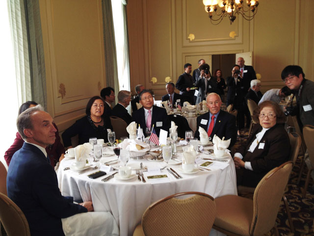 photo of guests sitting at round table set for lunch