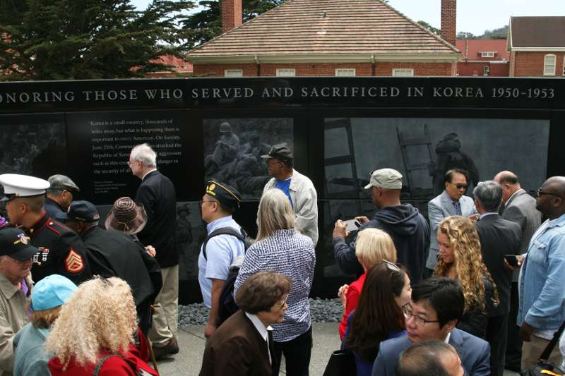 photo of visitors viewing memorial on opening day