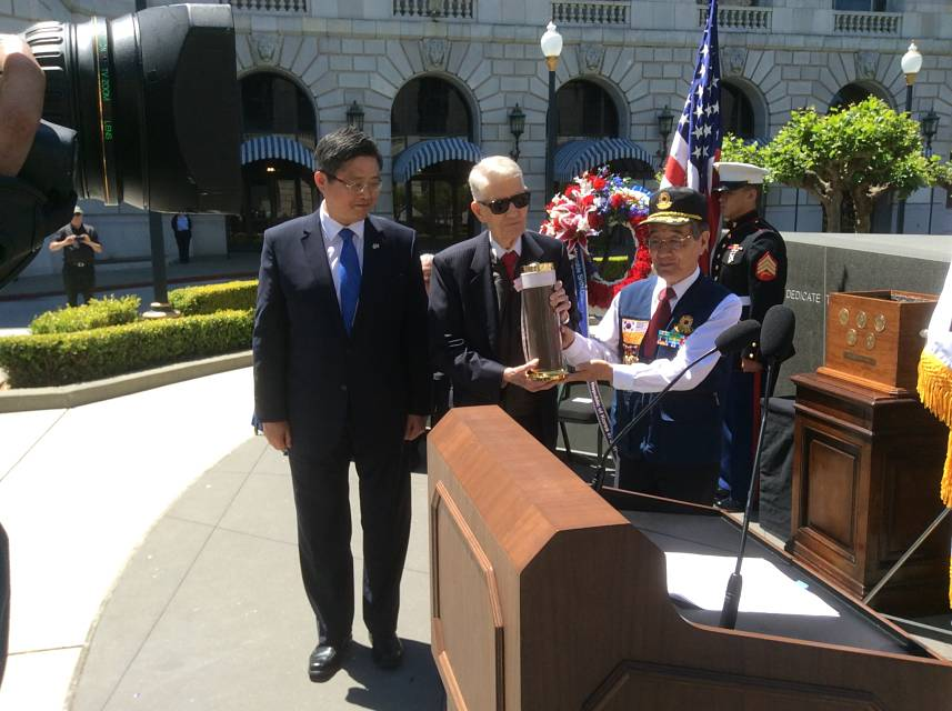 photo of Consul General Shin, Lieutenant Colonel Stevens, and Dr. Huh with the Korean battlefield soil