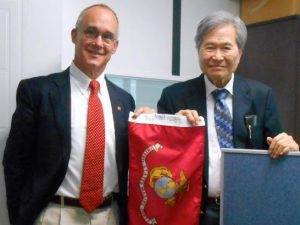 photo of Mr. Lee and Mr. Forney holding USMC flag