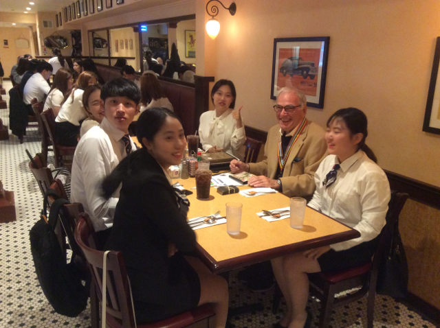 photo of Richard Friedman and student friends smiling at table
