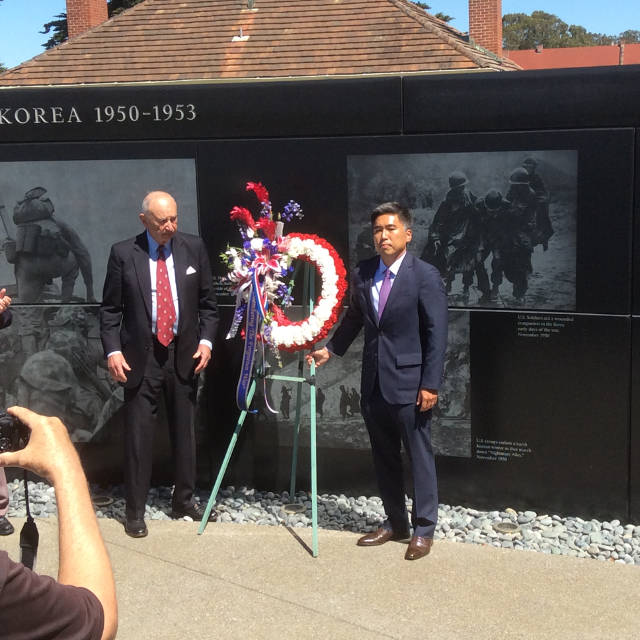 photo of Judge Kopp and DCG Kim with the wreath in front of the wall