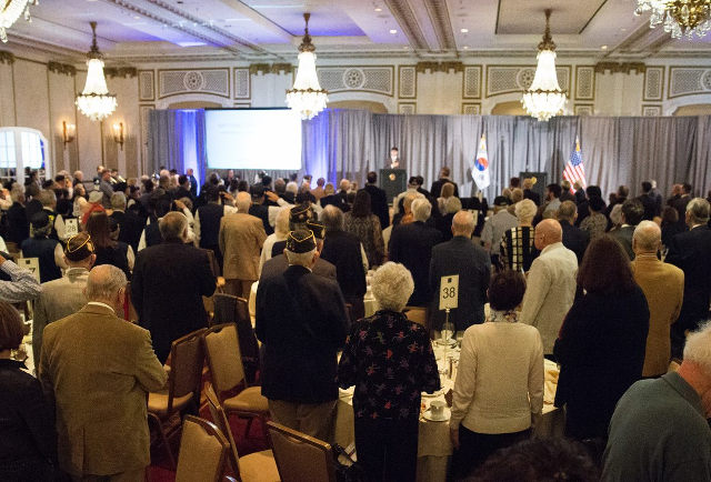 ballroom full of people reciting the pledge