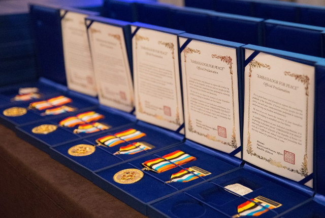 closeup of boxes of Ambassador for Peace medals