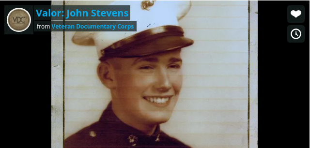 still frame from documentary showing a young John Stevens