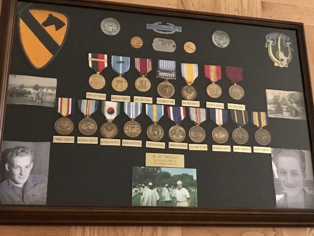 closeup of walts medals and memorabilia case