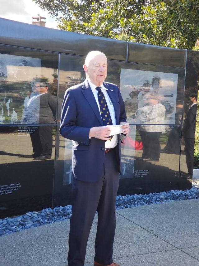 Quentin Kopp speaks in front of Memorial wall