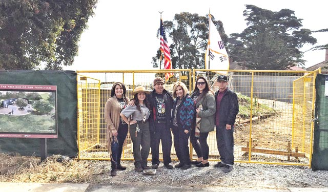 photo of Tony and family at site