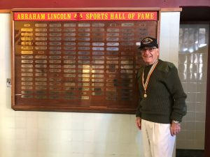 photo of Richard in front of Sports Hall of Fame at Lincoln