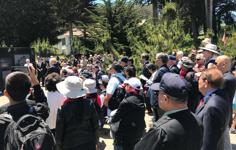 photo of crowd listening to speakers at the memorial