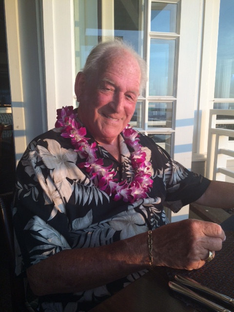 walt smiling wearing a lei