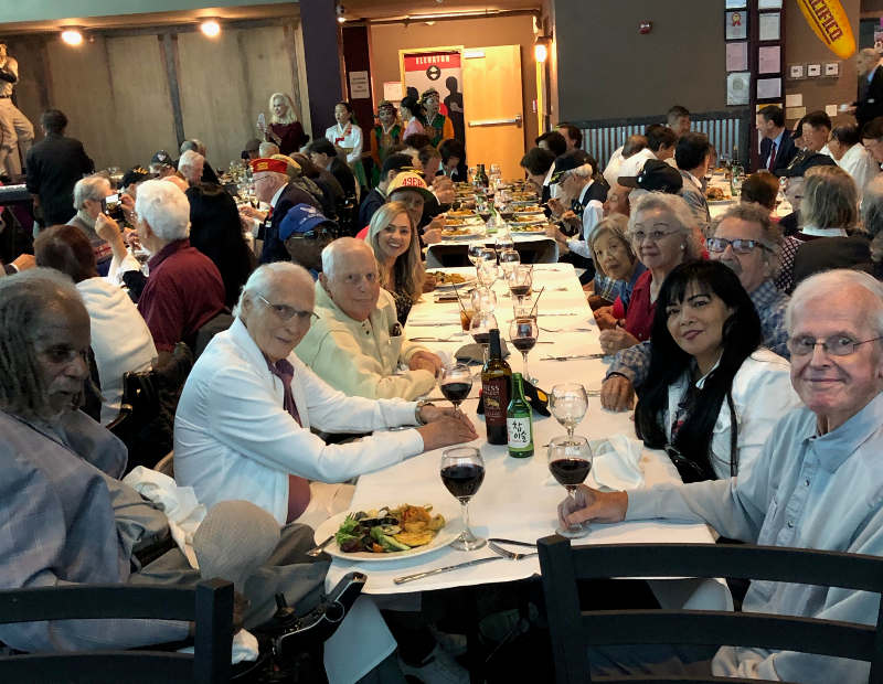Korean War veterans from the Veterans Home of California in Yountville smile for the camera as they eat lunch