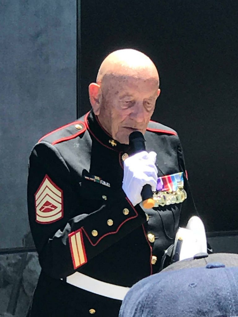photo of Denny Weisgerber speaking in uniform on Memorial Day