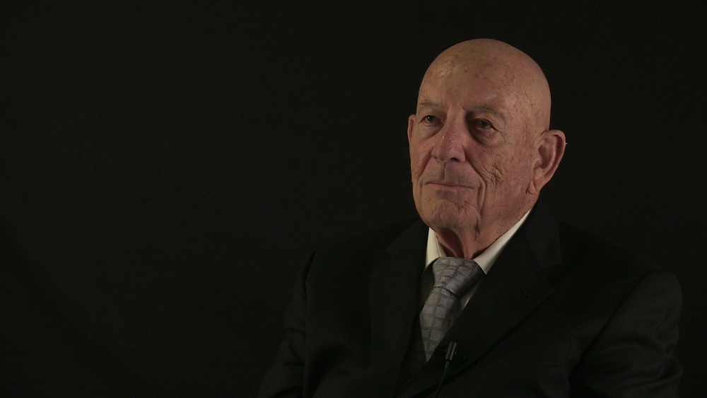 recent portrait of Denny on black background
